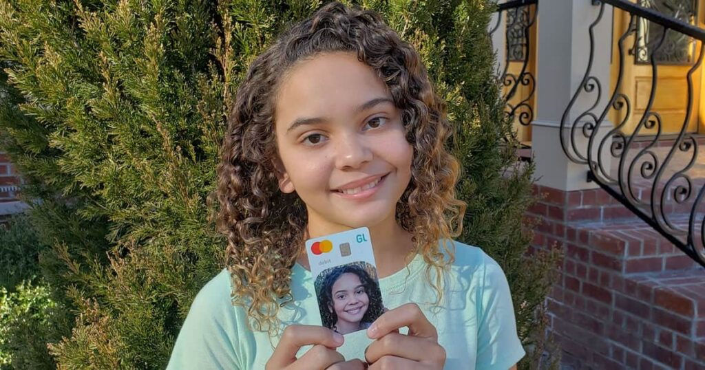 Picture of girl holding Greenligt Card